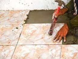 loose bathroom floor tiles repair or