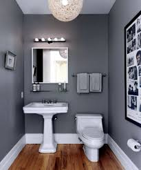 charcoal bathroom wall with nice white pedestal sink using chrome finished mirror and nice photo decor
