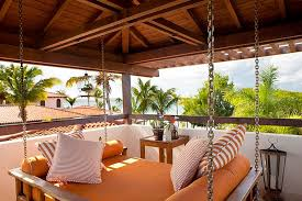 suspended outdoor daybed enhancing a tropical patio