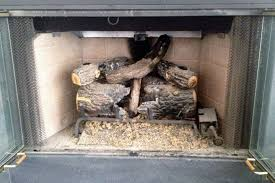 convert gas fireplace back to wood