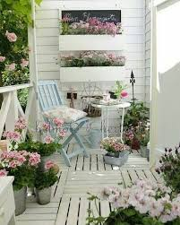 shabby chic patio garden. give your patio space a shabby chic overhaul with white painted wood and plenty of floral garden
