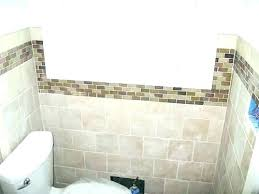 tile accent wall in bathroom tiled67