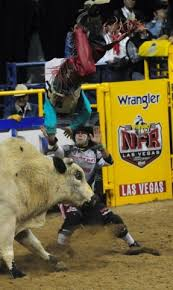 Bull rider Dustin Bowen from Waller, Texas, is bucked from his bull during  the first go-round of the 2015 Wrangler National Finals Rodeo at the Thomas  & Mack Center in Las Vegas