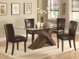 bold brown seat in glass dining table set with thick crossing wood leg also cream shades