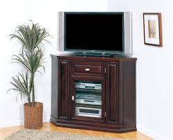 dark brown wooden dark brown tall corner tv stand with a glass door storage shelves and
