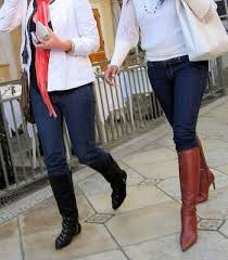 Image result for jeans tucked into boots women