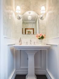 example of a classic powder room design in toronto with a pedestal sink and multicolored walls