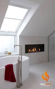 Beautiful Scandinavian bathroom with a Decoflame Montreal bioethanol  fireplace installed.