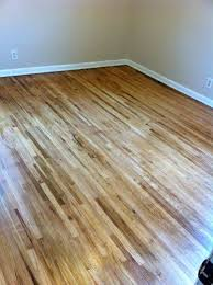 i didn t stain my floors i think the natural wood goes well with our house dark wood is more formal which our house isn t