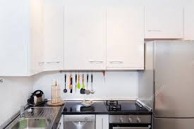 kitchensmall white modern kitchen. Wonderful Kitchensmall Interior Of Small White Kitchen Bright Modern Kitchen Background  Must Have Kitchenware And Appliances Stainless Steel Fridge Stove With A Flat  In Kitchensmall
