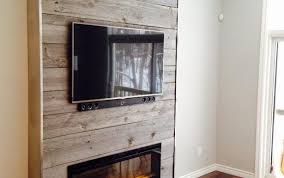 wooden reclaimed for behind flooring inserts burning accent above fireplace wall ideas mantel wood ornate plank