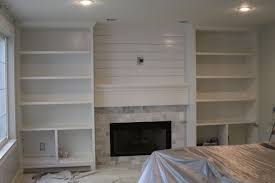 love the shiplap and stone in the center would add some cabinet doors on the sides
