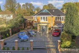 the luxurious home in st albans hertfordshire has a large driveway and a high