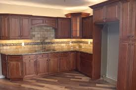 j k all wood kitchen cabinets in maple with a raised panel in a cinnamon finish
