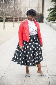 a polka dot shirt a polka dot midi skirt striped mules and a red