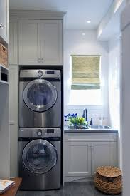 laundry sink cabinet laundry room transitional designing tips with white tile backsplash gray drawer beach style laundry room
