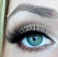 applying eyeshadow with eyelash