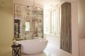 view full size french bathroom features a french candle chandelier hanging over