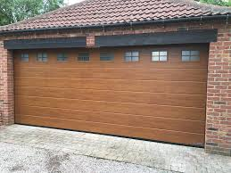 a hörmann sectional door m ribbed golden oak with windows