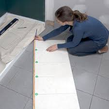 marking a board against a vertical tile layout to transfer the location of the top row