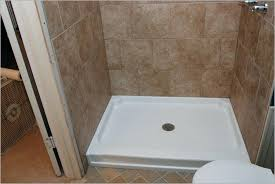 replacing tile in shower repairing bathroom