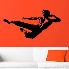 The legendary Bruce Lee in a classic pose of karate action #decals #stickers  #