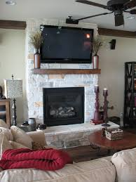 white oak country ledgestone by b cultured stone with wood mantel and wall mount flat screen