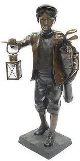 golf caddy with lantern bronze statue