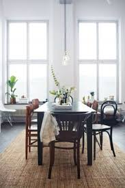 dark wooden dining table mismatched chairs wood white walls home decor