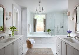 gray bathroom with white cabinets. inspiration for a timeless master white tile and stone corner shower remodel in austin with gray bathroom cabinets l