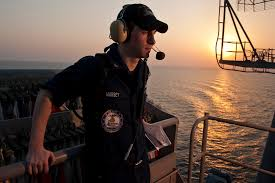 us navy intelligence specialist 3rd class ross massey stands on intelligence watch during the transit of navy intelligence specialist