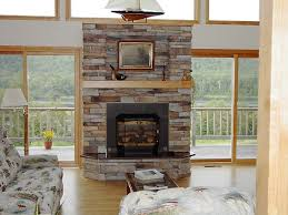All white stone indoor fireplace design with matching decor