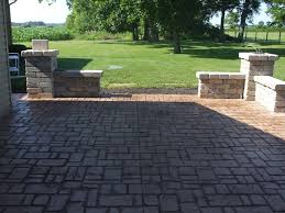 stamped concrete patio with walls