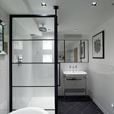 contemporary bathroom with a black frame for shower