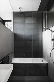 bathroom tile ideas use large tiles on the floor and walls large dark