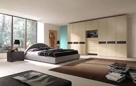 A Master Bedroom Closet Design Ideas With  Carpets And Black Shade Table Lamps