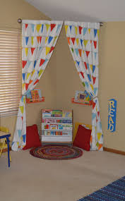 great idea for reading area in child's playroom - just hang curtain rod in  the corner