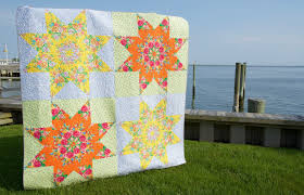 Sew Some Sunshine: Big Star Finish & I loved making this quilt, as it was a skill builder for me as a quilter. I  learned how to do y-seams confidently with this one. Adamdwight.com