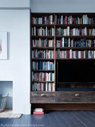 living with add book. roofing boards were repurposed to create the bespoke tv unit. cast bronze handles add perfect finishing touches - stoke newington living room with book c
