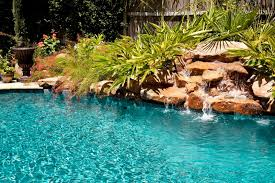 in ground pools with waterfalls. An Artificial Stone Waterfall With Lush Landscaping In Both Urns And Planted Around The Waterfall. Ground Pools Waterfalls I