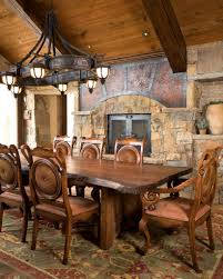 rustic farmhouse dining room design with old metal oversized chandeliers above large dining table ideas
