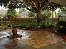 Small Picture This backyard landscaping centered around a large oak tree
