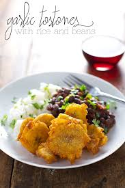 puerto rican rice and beans with chicken. Brilliant With Garlic Tostones On A Plate With Rice And Beans For Puerto Rican Rice And Beans With Chicken