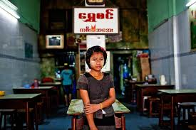 new york is an american special s and women in myanmar paint golden circles on their
