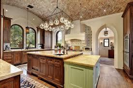 riviera kitchen cabinets mediterranean style kitchen with golden riviera granite countertops