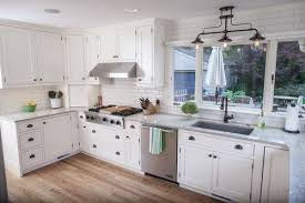 we wanted to keep the farmhouse feel and selected bright white cabinets quartz countertops an a sink and white subway tile backsplash
