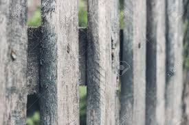 wood picket fence texture. Close Up Of Old Grey Wooden Picket Fence Panels. Vintage Wood Background. Selective Focus Texture A