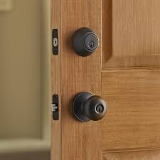 keyed entry door lever. keyed door knob and deadbolt on an entry door. lever i