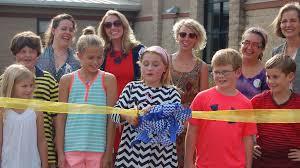 della davidson elementary school student molly cat tannehill center cuts the ribbon on the