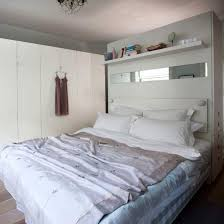 This headboard doubles as bedroom Storage wardrobe cabinet . Hidden drawers  hidden behind bed for streamlined looking bedroom white wardrobes go with  ...